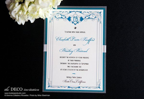 The Deco invitation with scroll design and crystal accent, initials at top and satin ribbon from...