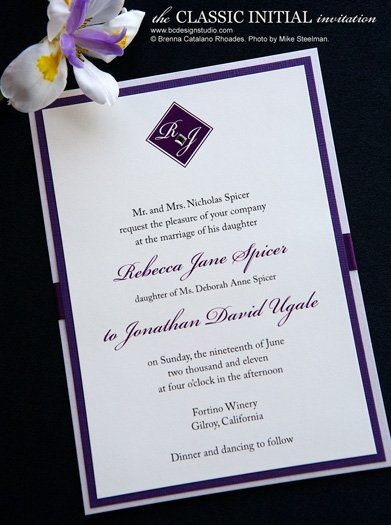 The Classic Initial wedding invitation with double layered backing, satin ribbon and crystal accent...
