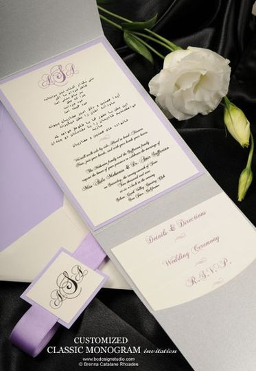 The Classic Monogram wedding invitation with layered backing, satin ribbon and thermography printing...