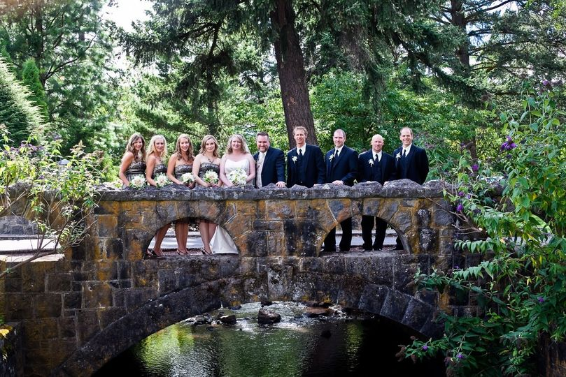 Newlyweds and guests on the bridge