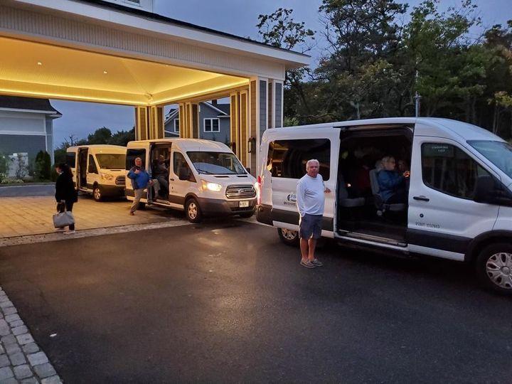 Convoy of white coaches
