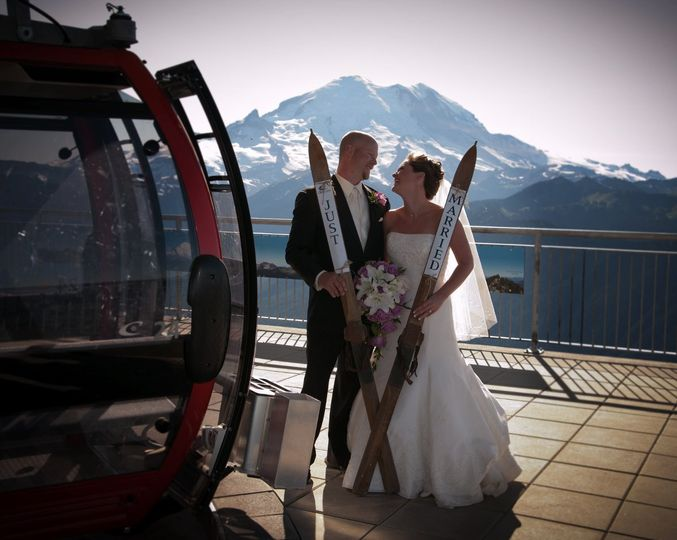 Groom and bride by the cable car