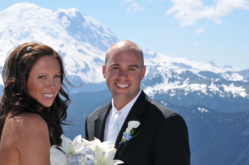 Bride and groom with the mountain in the back