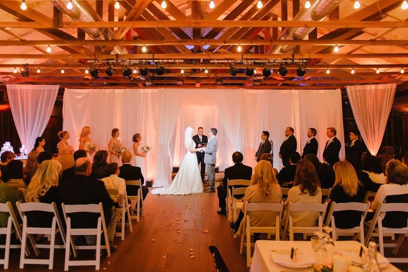 An intimate ceremony under wooden beams