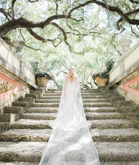 Justin Alexander Gown with a custom cape by Champagne & Grit, Photo by Erica J