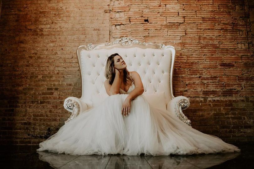 Bride on loveseat throne