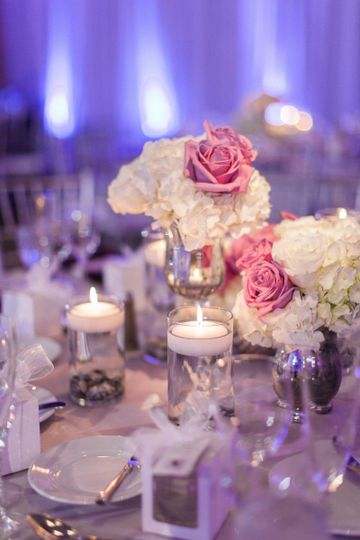 Table setup with candle and bouquet centerpiece