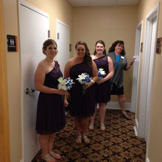 Bridesmaids ready for the ceremony.  Colors for the wedding were plum and teal blue.