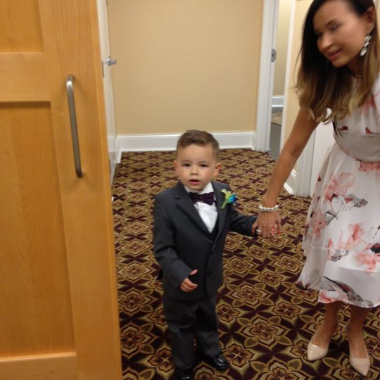 Cute ring bearer with a small version of the Groom's boutonnière.