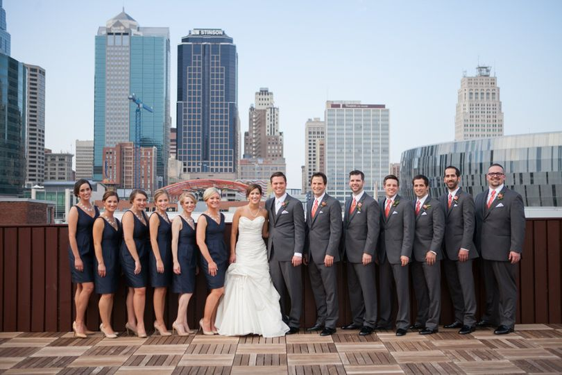 The couple with bridesmaids and groomsmen