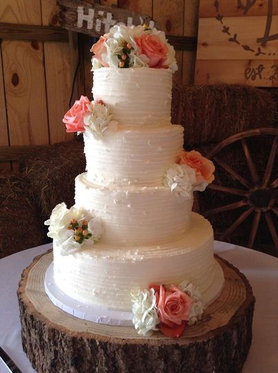 Four tier wedding cake with roses