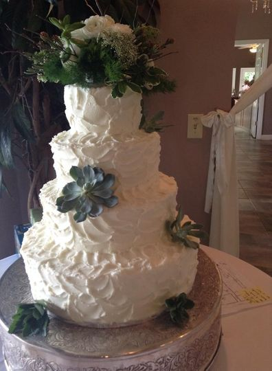 Five tier wedding cake with succulents