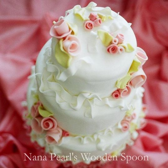 With windswept whimsy and an air of romance, this fondant cake is dotted with bunches of sugar roses...