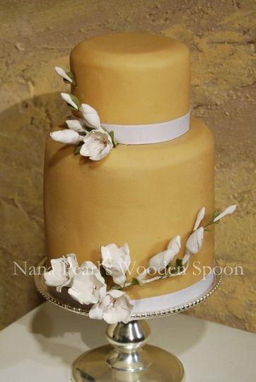 Contemporary with a nod to vintage art deco design, this cake is covered in marzipan and decorated...