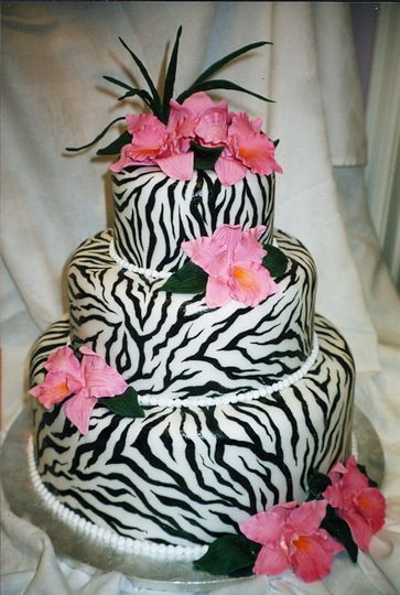 Hot pink sugar orchids add pop to this zebra-printed rolled fondant cake