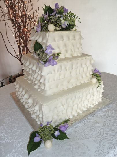 Ruffled rolled fondant layers add a sense of femininity to this cake