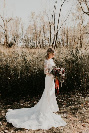 Bride in sleeved lace dress
