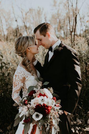 Newlyweds and wedding bouquet