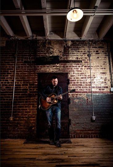 Guitarist by the door