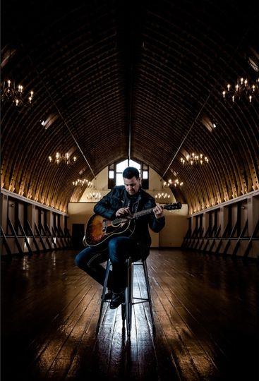 Playing his guitar