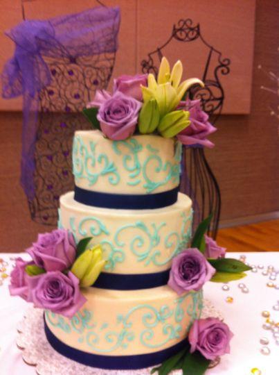 Three tier cake with purple flowers