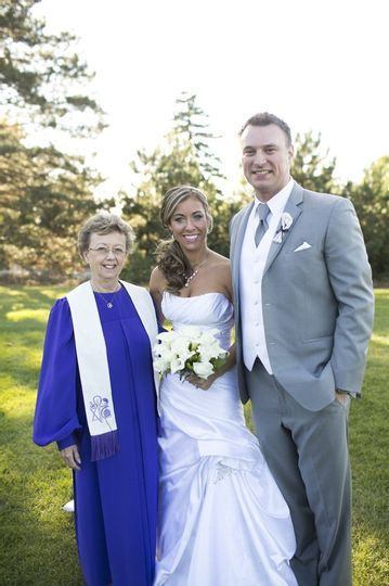 Officiant and newly weds