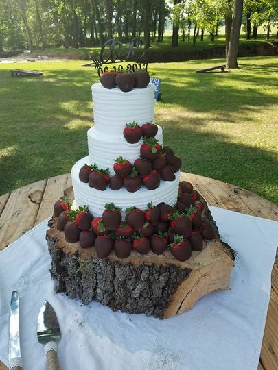 3-tier cake with choco-dipped strawberries
