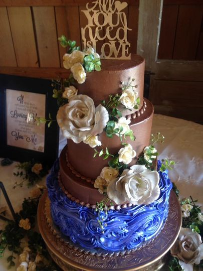Bronze wedding cake with blue tier