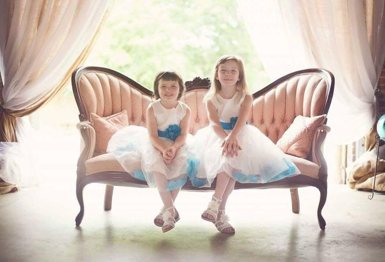 Flower girls seated on a couch