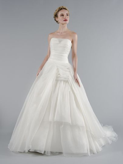 Style 33012105  This ball gown features a strapless neckline with a dropped waist in tulle. It has a...