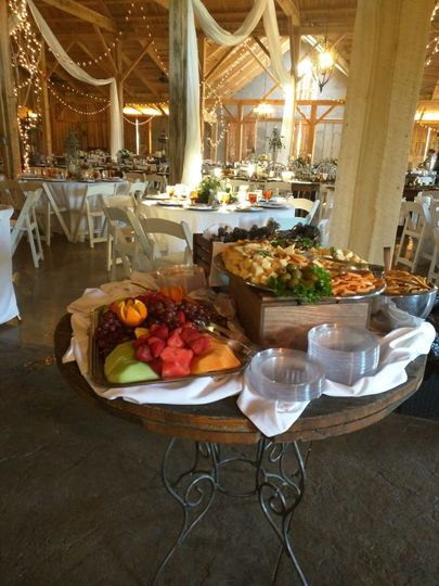 Fruit and Veggie Trays at a Rustic Barn Wedding with disposable serviceware