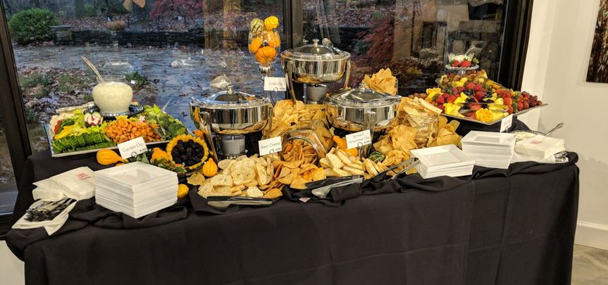 A hot dip bar display table with upscale disposables.