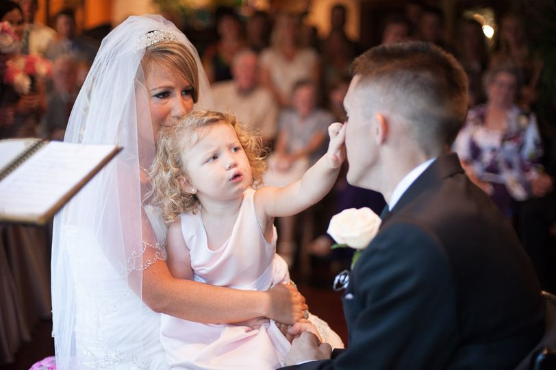 Daddy, Why are you crying? The brides daughter wipes away her new daddies tears as he says his vows....