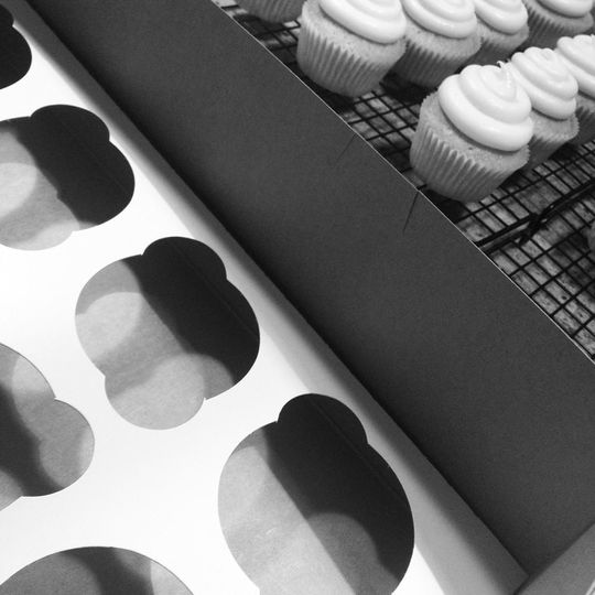 black white packaging with cupcakes