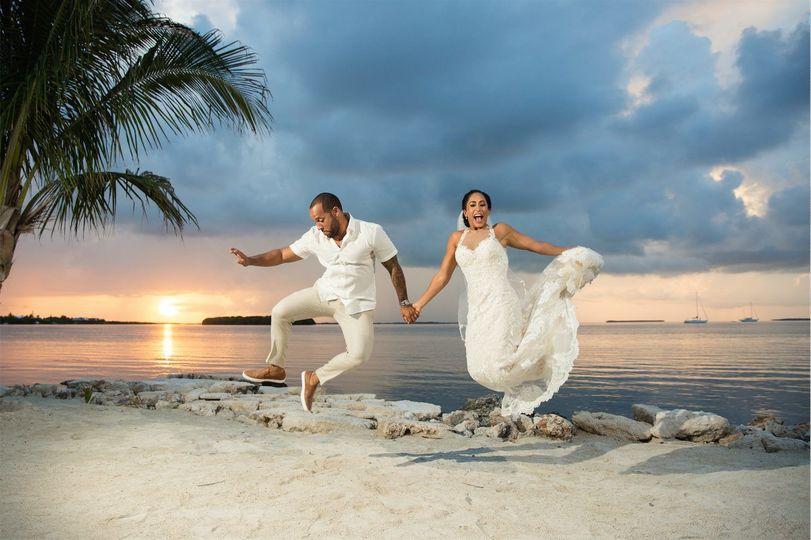 Jump shot of the newlyweds