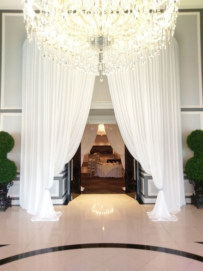 Grand entrance with white draping
