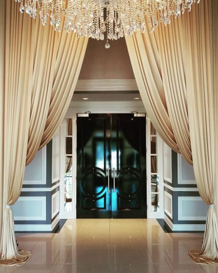 Grand entrance with gold draping