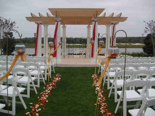 A beautiful ceremony set up featuring flowing fabrics and simple petals.