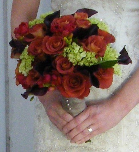 A combination of deep rich flowers brightened with green hydrangea create a sophisticated Fall...