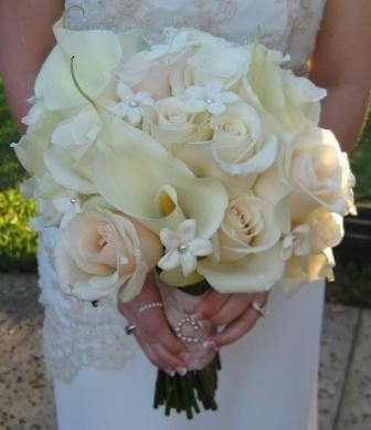A classic Bridal bouquet of Calla Lilies, Roses, and Stephanotis - trully beautiful!