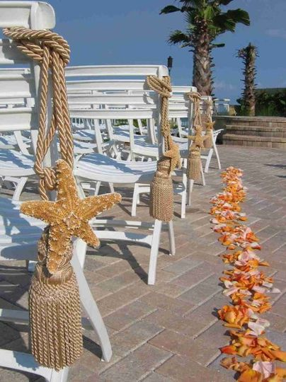 A beautiful beach scene enhanced by light accent pieces featuring tasseled starfish and Rose Petals.