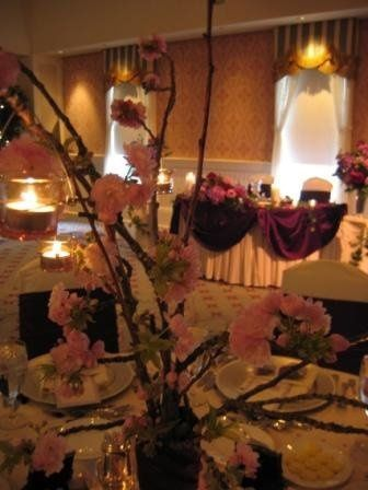 A stunning combination of deep purple linens and Cherry Blossom add dramatic impact to the...