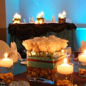 An illuminating display of style featured elegant tiffany linens, chocolate accents, Ivory Roses,...