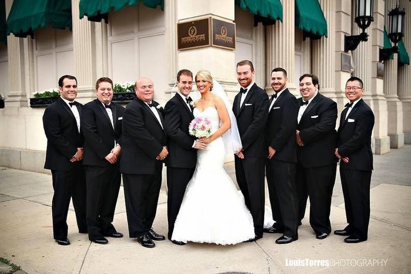 Newlyweds with groomsmen