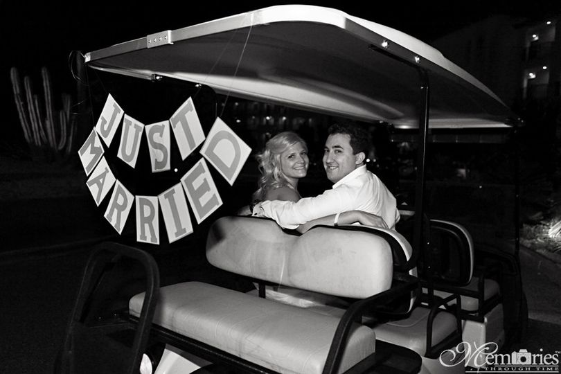 The couple at their bridal car