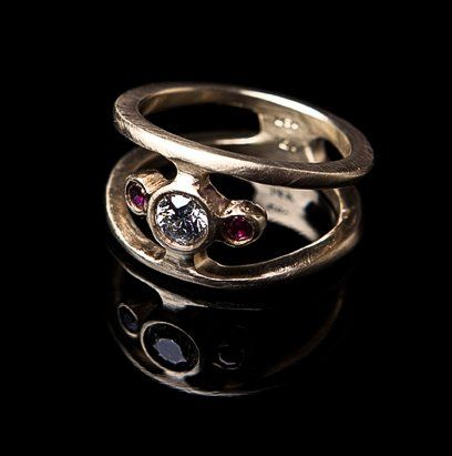 Custom designed Wedding Ring with sculptural cutout motif. This ring was designed using a repurposed...