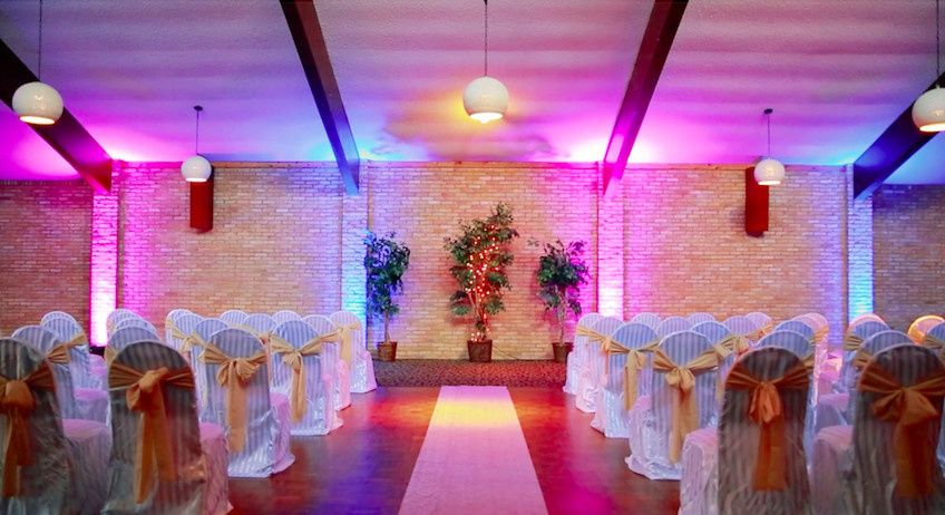 Indoor ceremony setup and lighting
