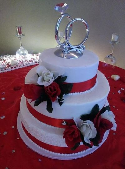 Red ribbons and ring cake topper