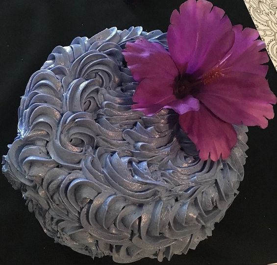 Icing detailing and purple flower