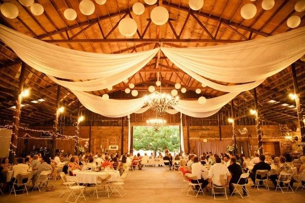 One of many rustic elegant barn weddings with the perfect atmosphere.  When you drape fabric and...